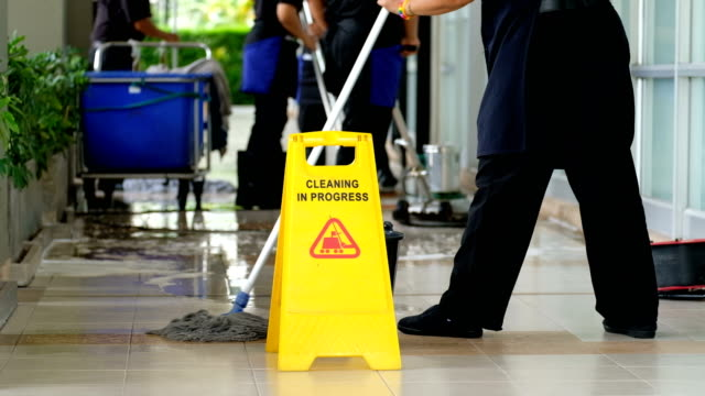 4k Cleaning service team cleaning floor with Scrubber machine